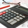 financial analysis concept with calculator,pen and glasses